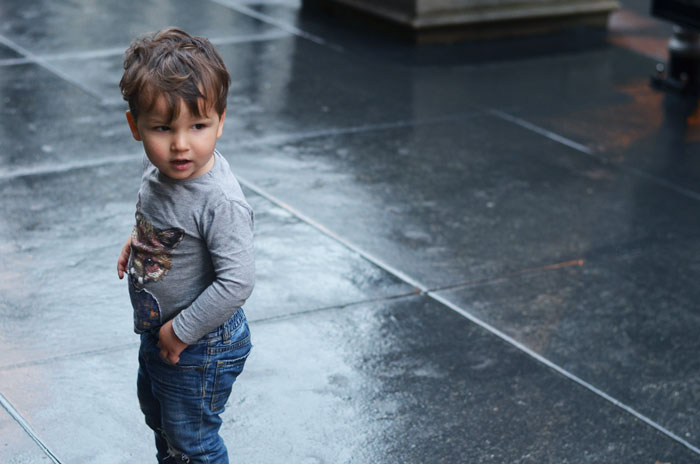 rain-sidewalk-toddler